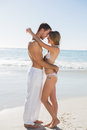 Gorgeous couple embracing on the beach Royalty Free Stock Photos