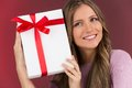 Gorgeous cute young woman holding present box