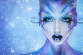 Gorgeous fashion portrait of beauty young adult girl with creative body art and snow on background Royalty Free Stock Photo