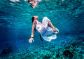 Gorgeous female dancing underwater Royalty Free Stock Photo