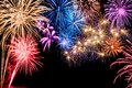Gorgeous fireworks display multi colored on black background with copyspace Royalty Free Stock Photo