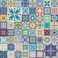 Gorgeous floral patchwork design. Colorful Moroccan or Mediterranean square tiles, tribal ornaments. For wallpaper print