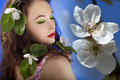 Gorgeous girl with flowers in hair glamour skin and make up studio shot Stock Photography