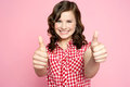 Gorgeous girl showing double thumbs up Royalty Free Stock Photography