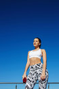 Gorgeous healthy woman with beautiful figure enjoying sunny afternoon during her daily workout training outdoors attractive female Royalty Free Stock Photo