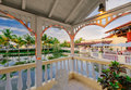 Gorgeous inviting view of resort grounds from the inside of gazebo in tropical garden at sunset time
