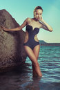 Gorgeous lady at the sea young in a black swimsuit Royalty Free Stock Images