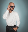 Gorgeous man in sunglasses and white shirt smiling Royalty Free Stock Photo