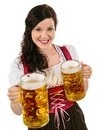 Gorgeous oktoberfest waitress with beer photo of a beautiful female wearing traditional dirndl and holding huge beers over white Royalty Free Stock Photography