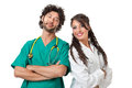 Gorgeous physicians a beautiful young doctor and an hand some nurse with sthetoscopes over white background Royalty Free Stock Photo