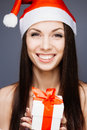 Gorgeous santa girl cheerful on gray Royalty Free Stock Image