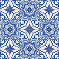 Gorgeous seamless patchwork pattern from dark blue and white Moroccan, Portuguese tiles, Azulejo, ornaments.