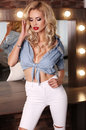 Gorgeous sensual woman with blond hair and bright makeup