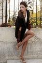 Gorgeous sensual woman with dark hair in elegant luxurious coat
