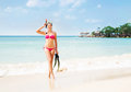 Gorgeous, slim, cheerful girl posing with diving mask and flippers on the seacoast in Thailand Royalty Free Stock Photo