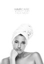 Gorgeous spa woman with a bored expression haircare concept and beauty close up of the face of young her hair tied in towel bare Stock Photo