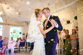 gorgeous stylish happy bride and groom performing their emotional first dance, wedding in a restaurant Royalty Free Stock Photo
