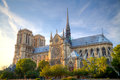Gorgeous sunset over Notre Dame cathedral with puffy clouds, Par Royalty Free Stock Photo