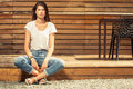 Gorgeous teen female model posing outdoor wearing jeans and t sh shirt on wooden fence background Royalty Free Stock Photography