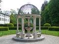 Gorgeous white pavilion with mini fountain of the English Garden Royalty Free Stock Photo