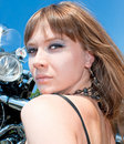 Gorgeous woman near by motorbike Royalty Free Stock Photo