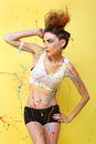 Gorgeous woman splashed with colorful paint beautiful Royalty Free Stock Images