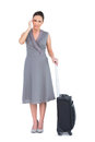 Gorgeous woman with suitcase suffering from headache while posing on white background Stock Images