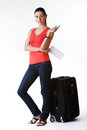 Gorgeous woman wearing summertime clothes full length standing next to her suitcase making plans for her travel shot in studio Royalty Free Stock Photography