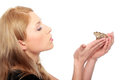 A gorgeous young blond woman kissing a frog Royalty Free Stock Photo