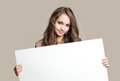 Gorgeous young brunette teen with blank sign. Royalty Free Stock Photos