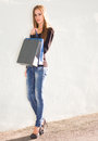 Gorgeous young shopper portrait of a girl holding colorful shopping bag Stock Image