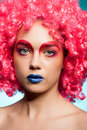 Gorgeous young woman with blue lips and pink wig Royalty Free Stock Photo