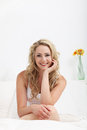 Gorgeous young woman relaxing on her bed Royalty Free Stock Photography