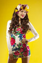 Gorgeous young woman smiling happy with hair made ​​of flowers studio Stock Image