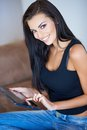 Gorgeous young woman surfing on a tablet-pc Royalty Free Stock Photo