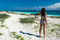 Gorgeous young woman in a swimsuit on the sea attractive girl w with beautiful figure tropical beach Royalty Free Stock Photo