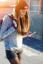 Gorgeous young woman wearing casual spring clothes walking down a city street Royalty Free Stock Photo