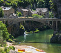 Gorges du tarn lozere linguedoc roussillon france famous canyon at summer village bridge and canoes Royalty Free Stock Images