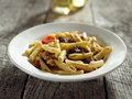 Gorgonzola cheese in pasta with beef and red bell Stock Photos
