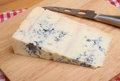 Gorgonzola italian blue cheese on cheeseboard with knife Royalty Free Stock Images