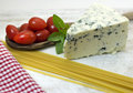 Gorgonzola italian ingredients tomatoes basil and pasta Royalty Free Stock Images