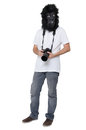 Gorilla man with a dslr camera mask isolated on white background holding Stock Images