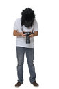 Gorilla man with a dslr camera mask isolated on white background holding and lookind at his Stock Photos