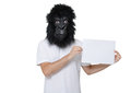 Gorilla man with a mask isolated on a white background holding a white banner Stock Images