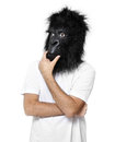Gorilla man thinking with a mask isolated on a white background in a position Royalty Free Stock Image
