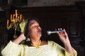 Gospel hymn mature singer with microphone singing during mass Royalty Free Stock Photography