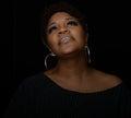 Gospel singer very nice portrait of a on black Stock Photo