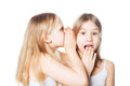 Gossip. Girl whispers to the friend secrets Royalty Free Stock Photo