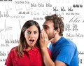 Gossip between a men and a woman Stock Image