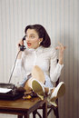 Gossip news business woman talking on phone at desk Royalty Free Stock Image